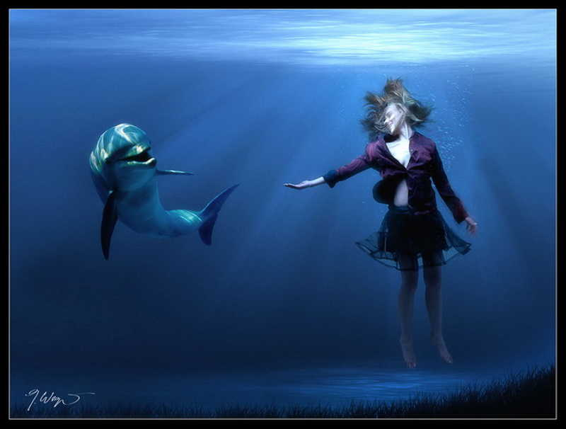Dziewczyna w wodzie z delfinem