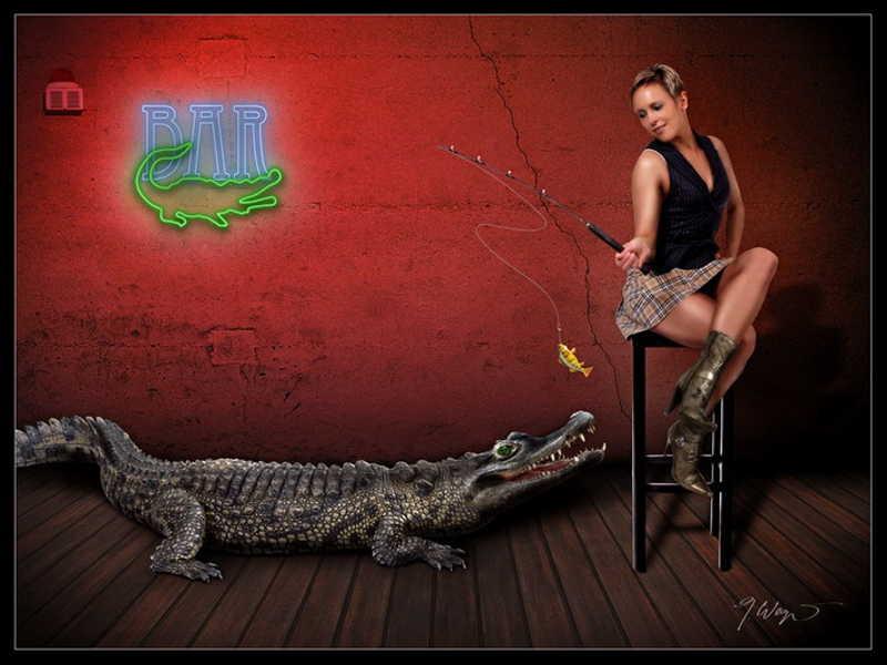 Dziewczyna łowi krokodyla na wędkę z przynętą w postaci rybki